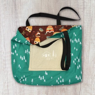 tote bag: green with white trees exterior and brown/multicolored owl print interior