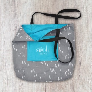 tote bag: grey with white trees exterior and bright blue solid interior