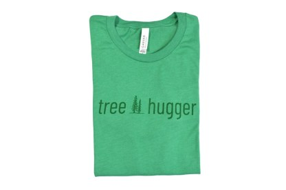"tree hugger t-shirt - folded green t-shirt that has two pine trees with ""tree hugger"""