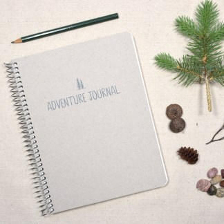 adventure journal with pencil and nature items