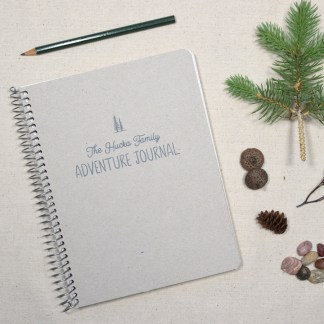 personalized adventure journal with pencil and nature items