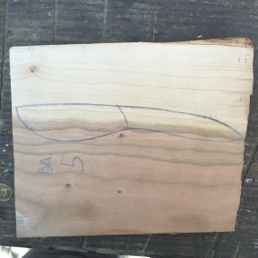 Select a piece of hardwood with a nice figure and sketch out the knife's outline.