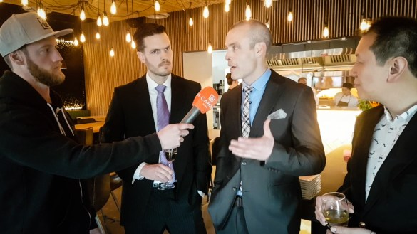 Owners of Copperhouse speak to Cabin Radio's Andrew Goodwin at a grand opening event in April 2018
