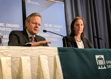 Bank of Canada Governor Stephen S Poloz, left, addresses reporters in Yellowknife in April 2018