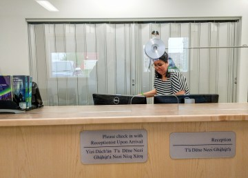A member of staff at the reception desk of Fort Resolution's health centre in June 2018