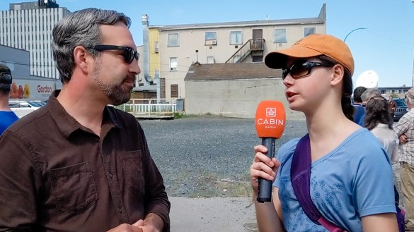 Cabin Radio's Alice Twa, right, interviews Yellowknife's Mayor Mark Heyck about a pop-up park proposal