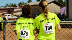 NWT Track and Field athletes watch events taking place at the 2018 edition in Hay River