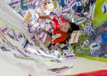 A contestant inside the Cash Cube at Yellowknife's 2018 GAP tournament