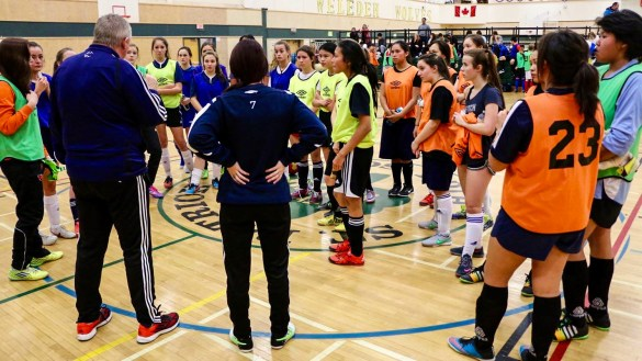Futsal players listen to NWT Soccer coaches at trials for the Arctic Winter Games in late 2015
