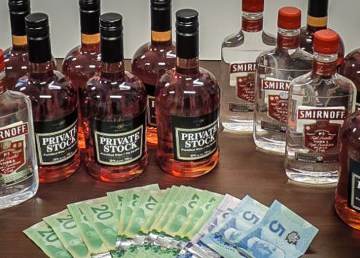 Liquor and cash seized by Yellowknife police in July 2018