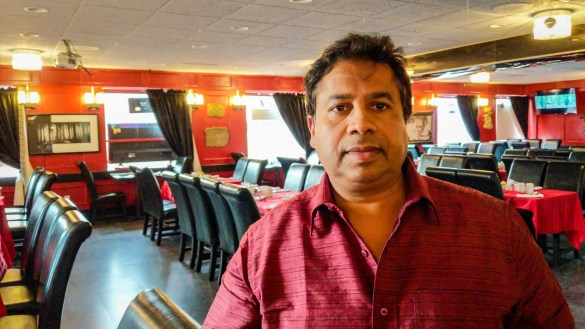 Mizanur Rahman Tito, owner of the The Ambassador in Yellowknife, inside the restaurant on its opening day