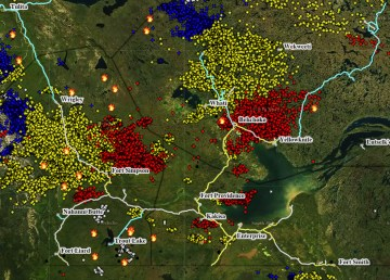 A map shows recent lightning strikes in the NWT as of 11pm on Thursday, with red being the most recent, alongside flames denoting existing wildfires