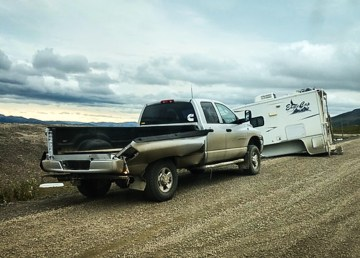 A photo posted online by the Department of Infrastructure shows a camper separated from a truck on the Dempster Highway