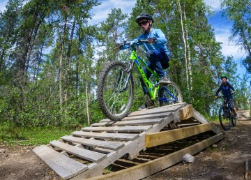 Connor Burns tackles a feature during a bike camp held in Yellowknife