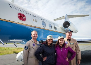 Mandy Bayha, centre left, and Joanne Speakman, centre right, with members of NASA flight crew in front of a Gulfstream III jet