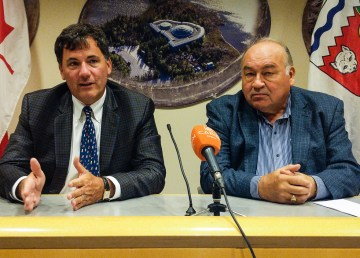 Northern Affairs Minister Dominic LeBlanc, left, talks to reporters in the company of Premier Bob McLeod in Yellowknife on August 20, 2018