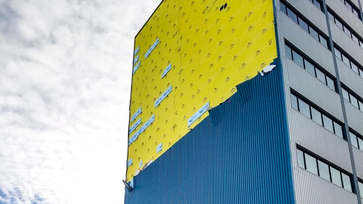 Siding stripped from the side of Yellowknife's Bellanca building
