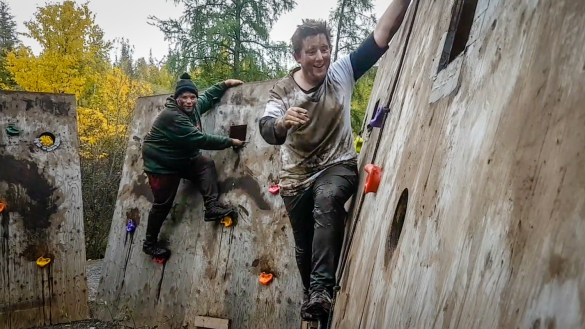Jesse, left, and Ollie take on the 2018 mud run in Yellowknife