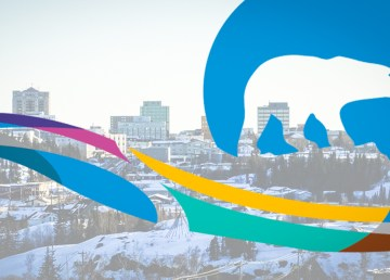 A composite image of the territorial government's logo and the Yellowknife skyline