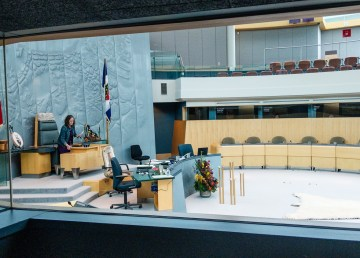 A staff member prepares documents ahead of a sitting of the NWT legislature in May 2018