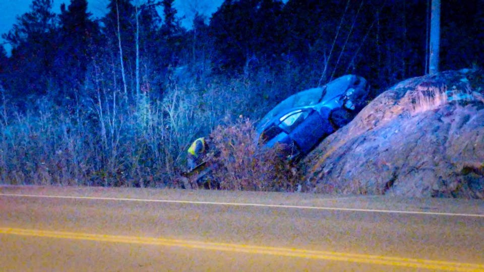 A vehicle is seen beached on a rockface on a highway leading into Yellowknife on October 4, 2018