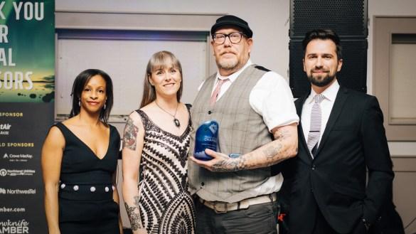 Karen Wasicuna, centre left, and Robin Wasicuna, centre right, accept their customer service award