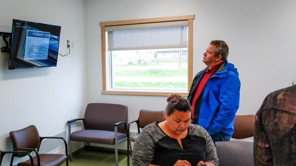 Glen Abernethy studies a screen inside Fort Resolution's health and social services centre in June 2018