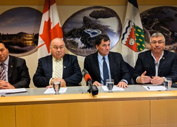 From left, NWT infrastructure minister Wally Schumann, NWT Premier Bob McLeod, federal northern affairs minister Dominic LeBlanc, and NWT MP Michael McLeod