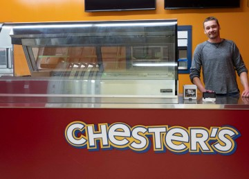 Dwayne Buhler stands in Hay River's soon-to-be-open Chester's Chicken. Sarah Pruys/Cabin Radio
