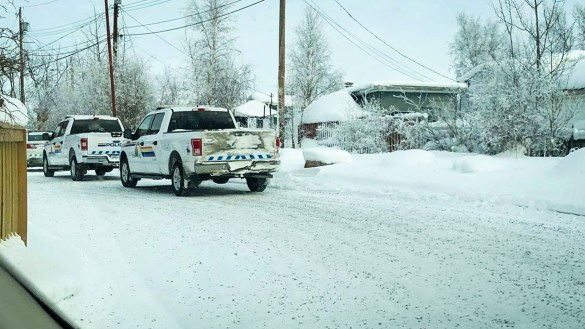 RCMP vehicles are pictured outside Yellowknife's Borealis Housing Co-operative on February 14, 2019