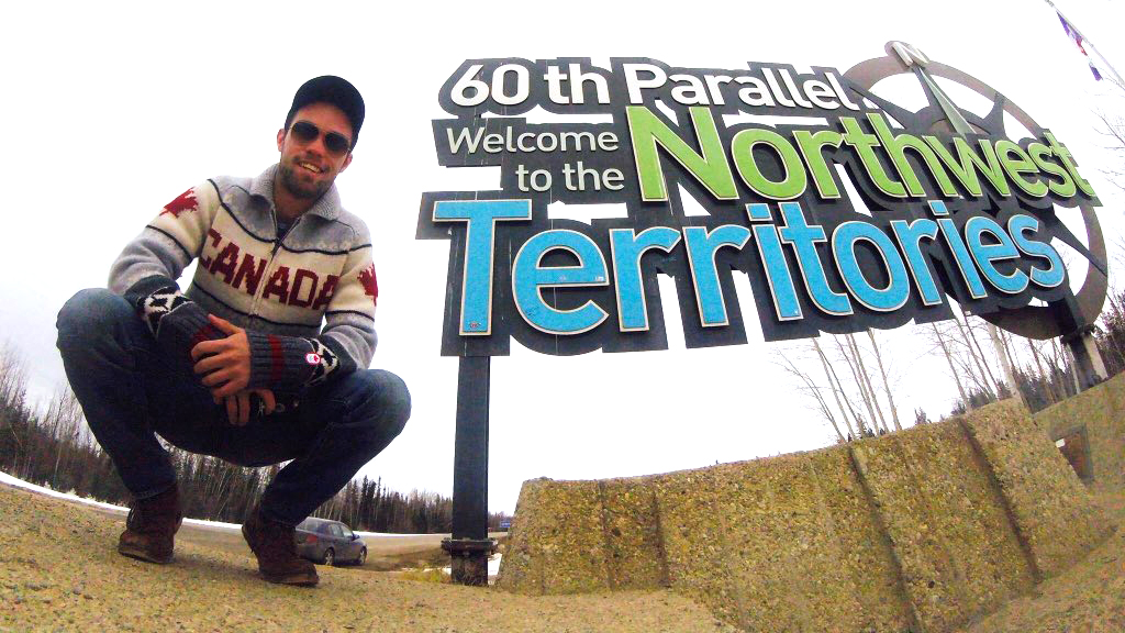 Zachary McKillop at the Northwest Territories border sign. Submitted photo.