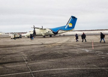 A Canadian North flight awaits passengers on the tarmac at Yellowknife Airport in March 2019