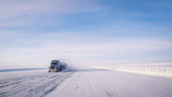 A view of a truck making its way along the winter ice road through the Slave Geological Province