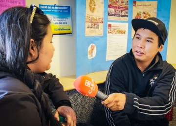Melvin Vital, left, a Nahanni Butte resident, practises his interviewing technique during a Cabin Radio workshop in March 2019