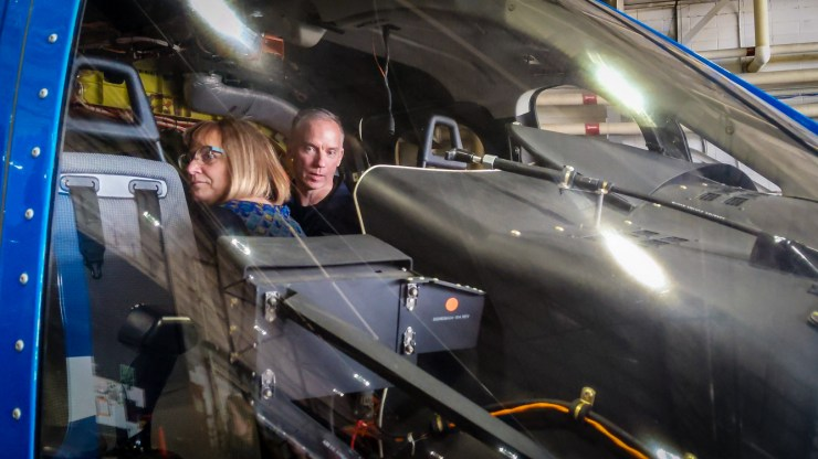 NWT Tourism's Cathie Bolstad, left, and Bell test pilot Pat Lindauer sit inside a Bell 525 Relentless helicopter at Yellowknife Airport