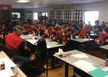 Fire crews at a meeting on Monday plan for the protection of buildings in High Level