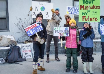 Student Ella Kokelj, left, stands with fellow protesters during a school strike for climate in Yellowknife on May 3, 2019