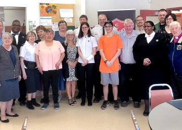 Yellowknife Salvation Army staff and volunteers pose for a photo after a volunteer appreciation event on Sunday