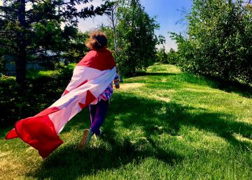 A child with a Canadian flag