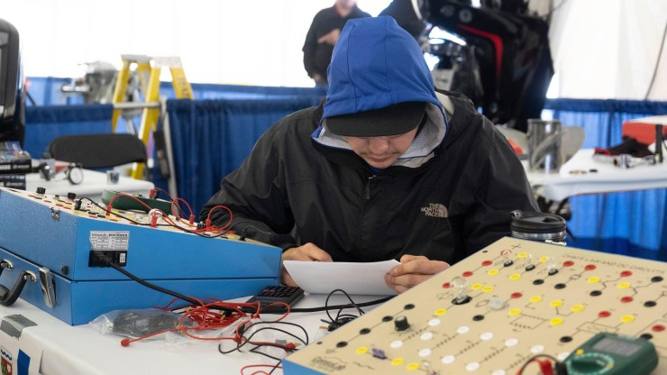 Branden Jumbo works on a task for outdoor power and recreation equipment at the Skills Canada National Competition. Sarah Pruys/Cabin Radio