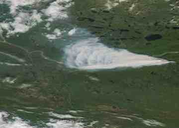 A NASA WorldView satellite image from July 26, 2019 shows a wildfire east of Tsiigehtchic in the Mackenzie Delta