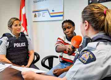 Crystal Kisakye, centre, interviews RCMP officers Cpl Charmaine Parenteau (left) and Cst Heather Cosenzo