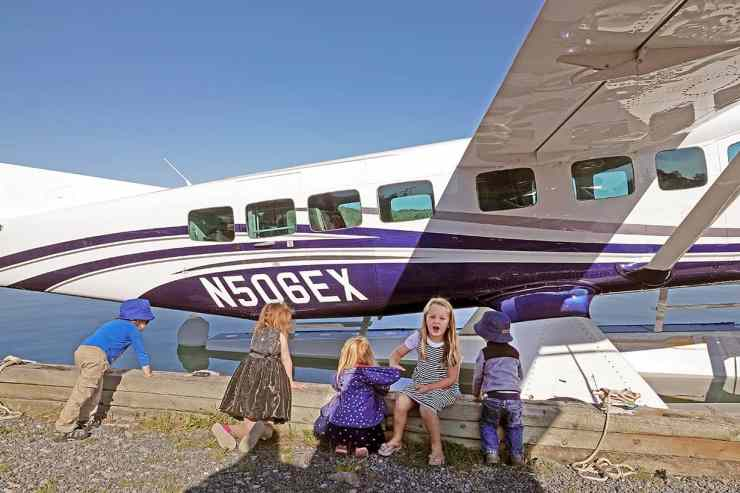 Children admire a new Cessna Grand Caravan Amphibian brought in as a demonstration vehicle for sale.
