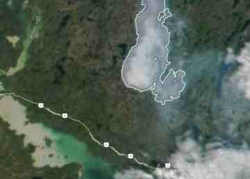 The smoke plume from a wildfire northwest of Yellowknife, highlighted in white, is shown on satellite imagery from July 19, 2019