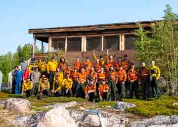 A photo shows Ontario firefighters at the Awry Lake fire's base camp