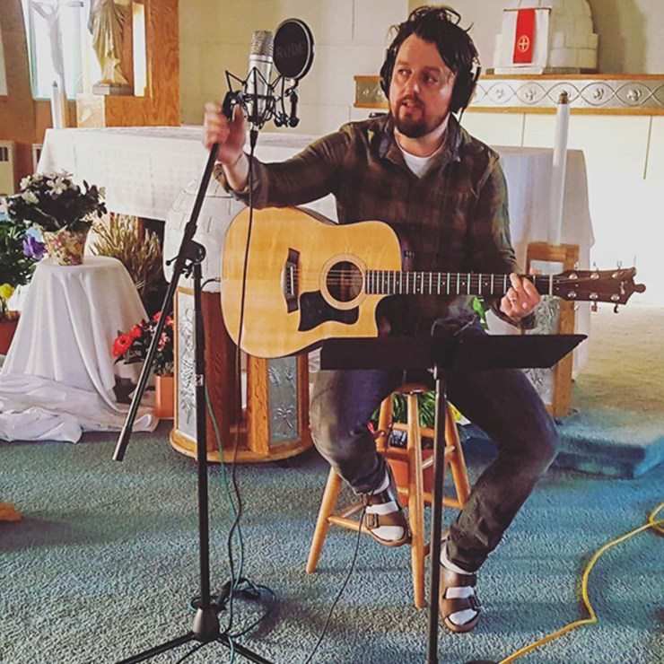 Abe Drennan recording inside the Igloo Church in Inuvik