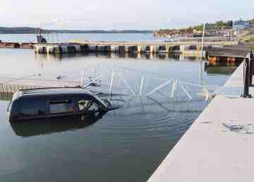 A vehicle sits submerged in Yellowknife's Back Bay on August 11, 2019