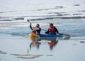 Kayakers head out for a paddle during Sachs Harbour's Oceans Day in July 2019. Inuvialuit Regional Corporation photo