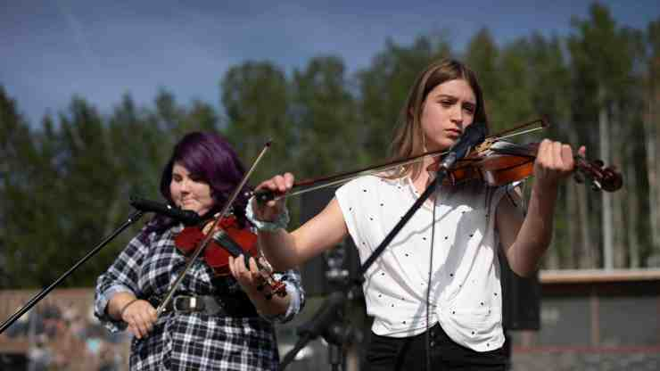 Members of the Kole Crook FiddlingAssociation play at the RCMP Musical Ride. Sarah Pruys/Cabin Radio