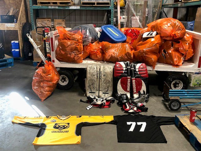 Hockey equipment awaits transport at an Air Tindi hangar